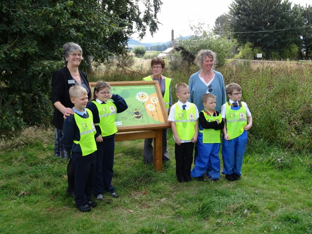 Sheila Downie from Scotmid's North Regional Committee with the new bumblebee board.