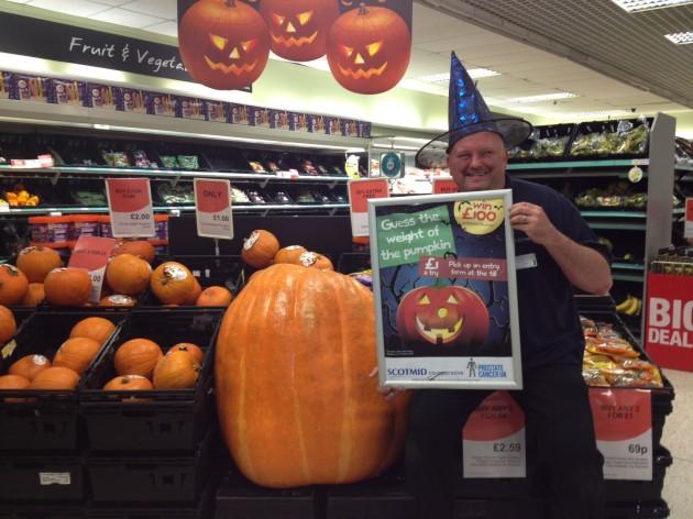 Team member Phil Henderson with the pumpkin at Scotmid Portobello.