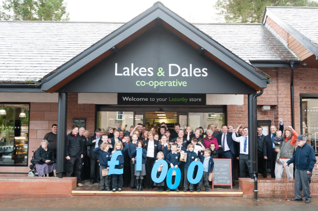 Staff, customers and local school children help open the store.
