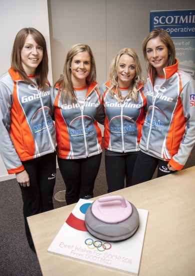 The team with their curling stone cake.