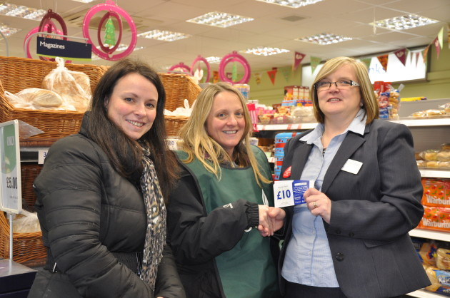 Julie and Nicola from the foodbank with Scotmid Westcraigs Store Manager, Angela Crossar.