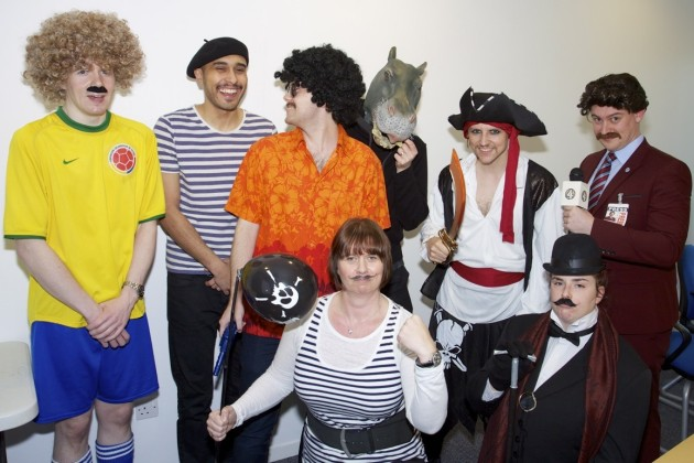 Staff dresed up as moustachioed celebrities to raise funds.