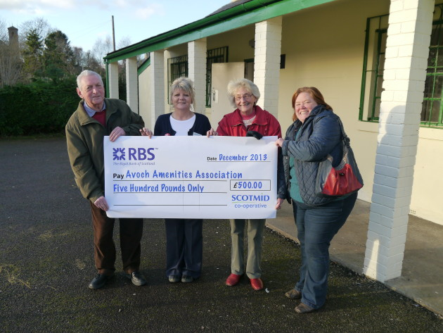 Avoch Amenities Association accepts a cheque from Scotmid Co-operative.
