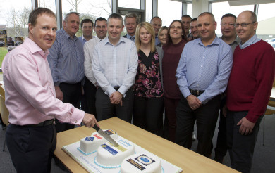 Chief Operating Officer, Colin McLean, cuts the cake to celebrate the 100th bakery.