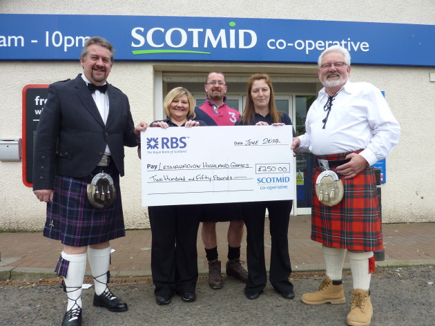 The Scotmid Lesmahagow team presents the cheque for the Highland Games.