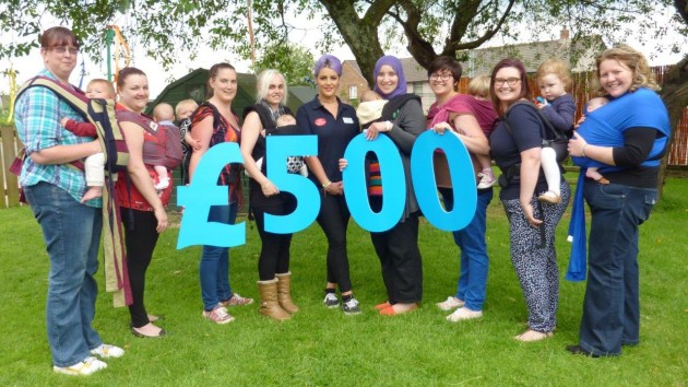 Slinging Around celebrates their £500 grant from Scotmid.
