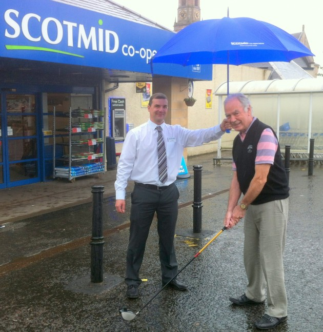 Store Manager John McIntosh with Bill Clemenson from the Open