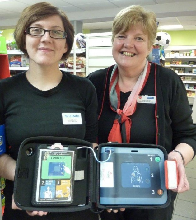 Nicola Watters and Liz McIntyre from Scotmid Ballantrae with their defibrillator.