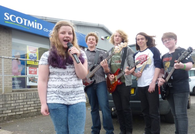 Local band Dusty Custard celebrate the grant.
