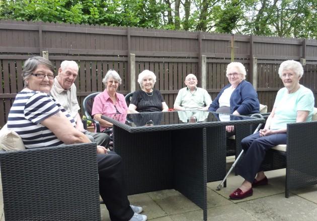 Carron Court residents enjoy their brand new garden furniture.