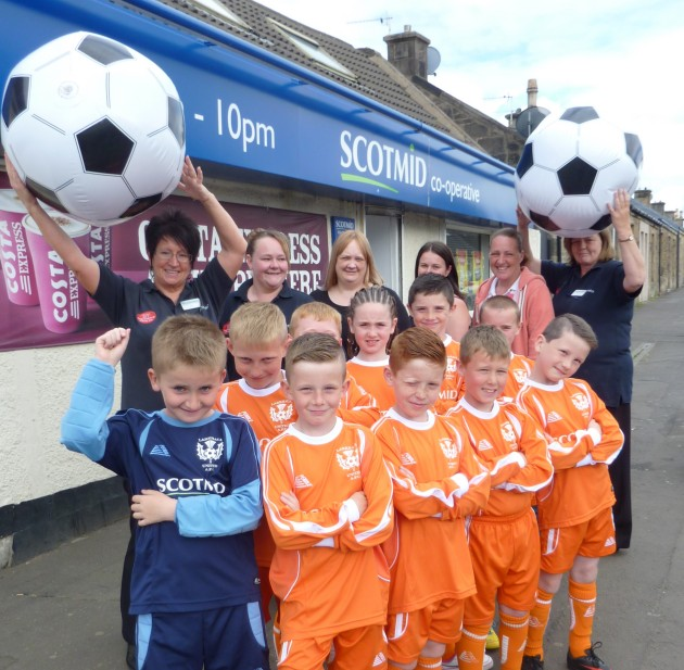 Larkhall United celebrates their grant with Scotmid Larkhall staff.