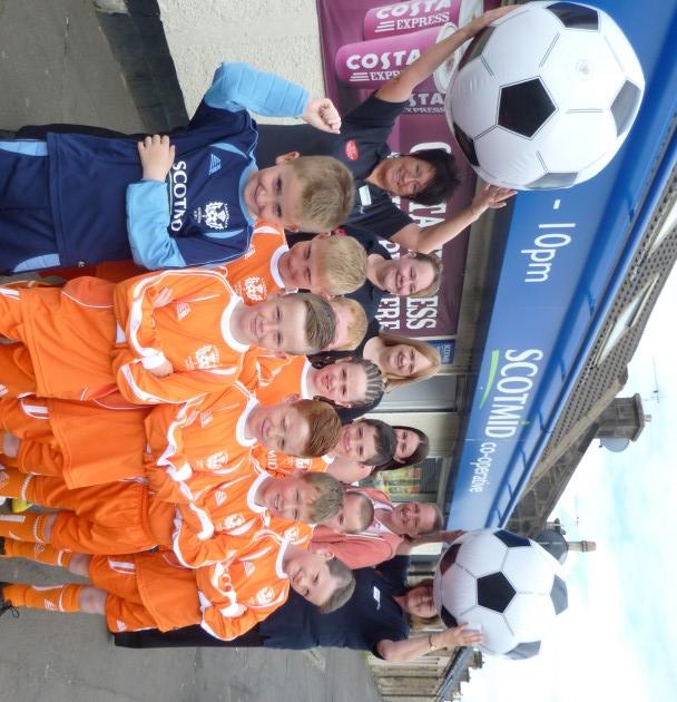 Larkhall United celebrates their grant with Scotmid Larkhall staff.