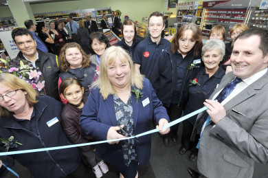 Store Manager Rose Spence cuts the ribbon to open the store.