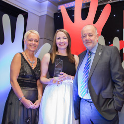 Kath Parr (left) presents the award to Scotmid's Laura Paterson and Malcolm Brown