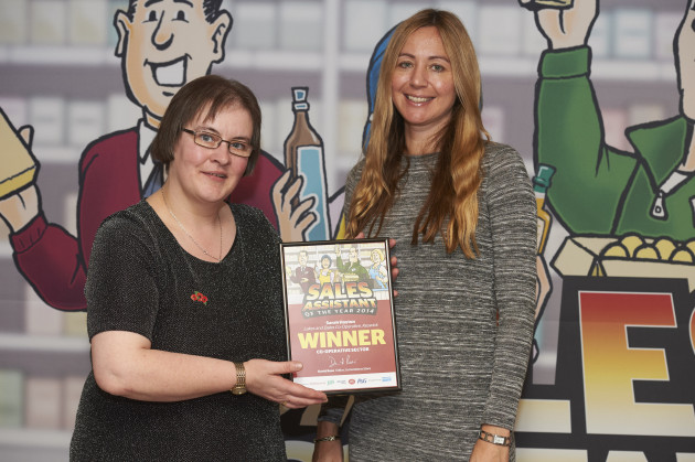 Sarah receives her award from Selena Taylor of Coca Cola Enterprises