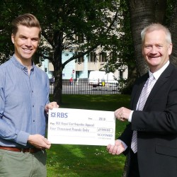 Scotmid's Neville Muir (r) presents a cheque to Neil Mathers, DEC