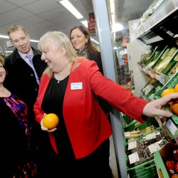 Maureen Watt, Minister for Public Health meets Moredun Store Manager, Rose Spence.  John Brodie & Kimberley Guthrie, Scotmid's Marketing Director, look on.