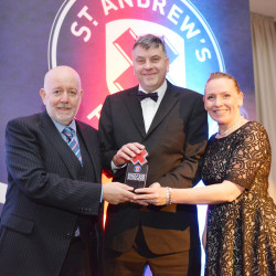 Scotmid Co-operative's Head of Corporate Communications Malcolm Brown and Membership and Community Manager Patricia Edington receive the award from St Andrew's First Aid's Chief Executive Stuart Callison at the ceremony in Glasgow.