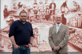 Local artist Tom Ewing with Scotmid Co-operative President Harry Cairney, in front of the mural