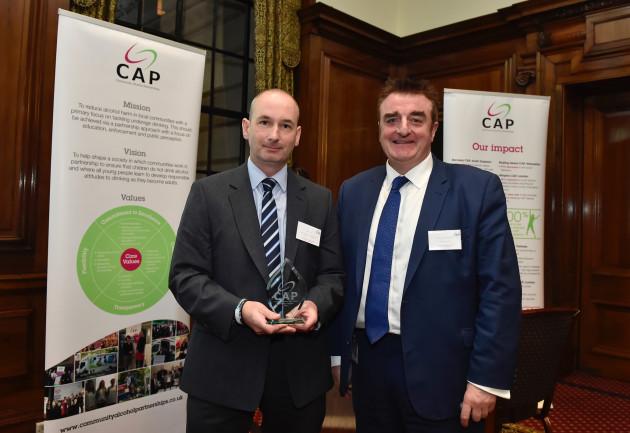 Ian Lovie receives his CAP award from Tommy Sheppard MP